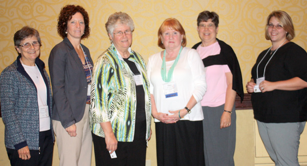 Five year pins (from left): Sister Annette Allain, LSA; Jane Buse, Peg Johnson, SCL; Eileen Dickerson, Mary Kabat, OSF; and Sandy Nash